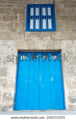 Architectural details of Old Havana, old vintage Spanish colonial large doors Old Havana is a UNESCO world heritage site and a major tourist landmark - stock photo