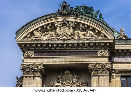 Architectural details of Opera National de Paris: West facade. Grand Opera (Garnier Palace) is famous neo-baroque building in Paris, France - UNESCO World Heritage Site.