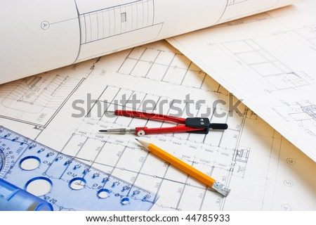 architectural drawing with a ruler and compass