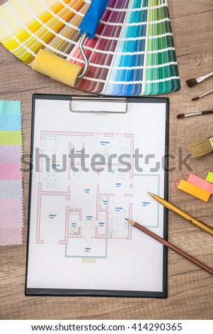architectural drawing with work tools and accessories for home renovation - stock photo