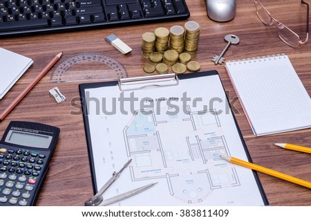architectural drawings of the modern house with computer keyboard, calculator, notepad, pen, coin and pencil