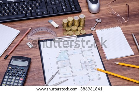 architectural drawings of the modern house with computer keyboard, calculator, notepad, pen, coin and pencil - stock photo