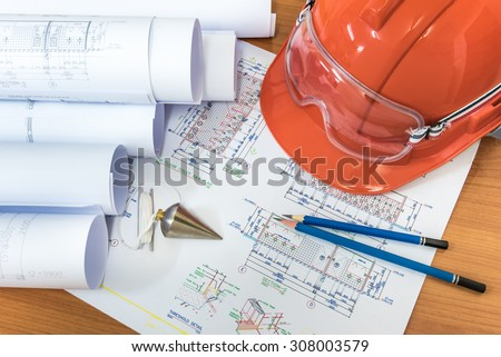 Architectural drawings paper with equipment on the table - stock photo