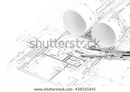 architectural drawings with floor plan and drawing compass - stock photo