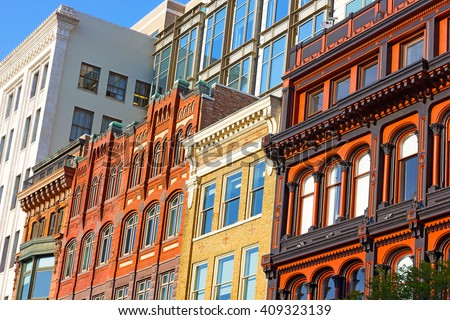 Architectural elements of Washington DC buildings. Metro Center neighborhood buildings under the afternoon sun. - stock photo