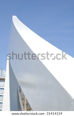 Architectural feature on footbridge in Glasgow, Scotland set against blue sky background