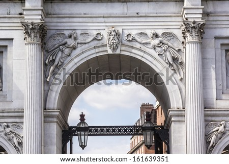 Architectural fragment of Marble Arch - 19th-century white marble faced triumphal arch and London landmark. Marble Arch was designed by John Nash in 1827. West End, London, England. - stock photo
