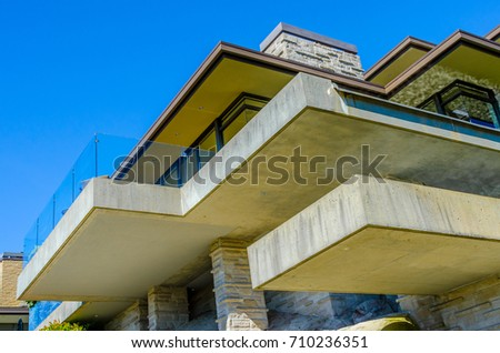 Architectural fragment:  side of the modern house with the balcony. Vertical.