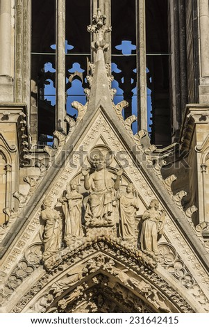 Architectural fragments of Notre-Dame de Reims facade (Our Lady of Reims, 1275). Reims, Champagne-ardenne, France. It is the seat of the Archdiocese of Reims, where the kings of France were crowned. - stock photo