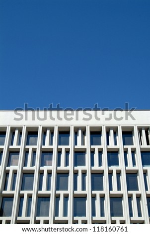 Architectural grid work with blue sky background