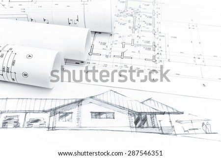 architectural hand drawing with architect rolls and plans