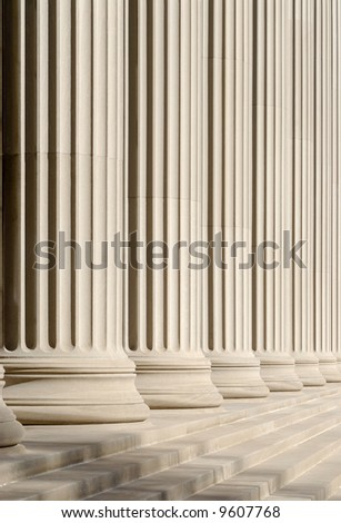 Architectural pattern of classic columns and steps - stock photo