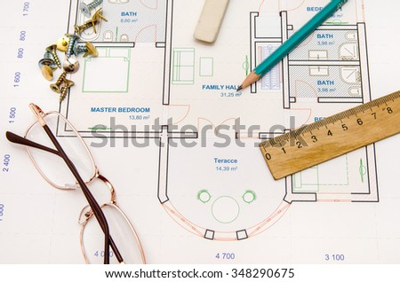 Architectural plan, glasses, pencil and ruler