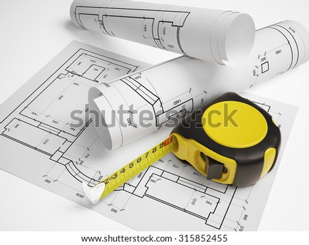 architectural plan with a tape measure - stock photo