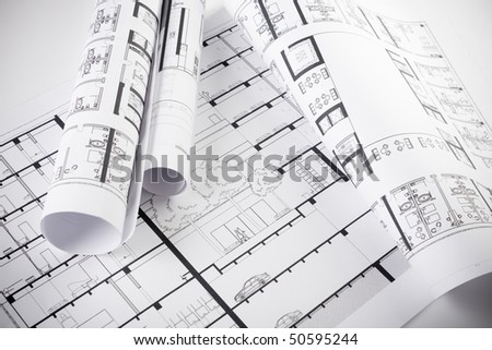 Architectural plans and blueprints in office