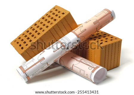 architectural plans and bricks over white background - stock photo
