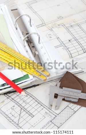 Architectural plans old paper tracing paper stock photo 115174111 architectural plans of the old paper tracing paper measuring tools and file with the project malvernweather Images