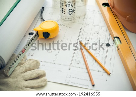 Architectural project and ruler on the table - stock photo