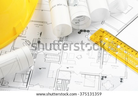 Architectural project and yellow helmet - stock photo