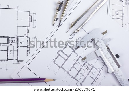 Architectural project, blueprints, blueprint rolls and divider compass, calipers on plans Engineering tools view from the top. Copy space. Construction background. - stock photo