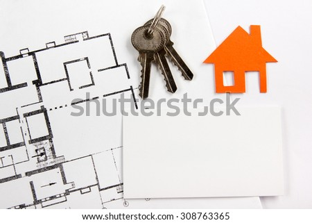 Architectural project, blueprints, silver key with house figure and blank business card on wooden background. Real Estate Concept. Top view. - stock photo