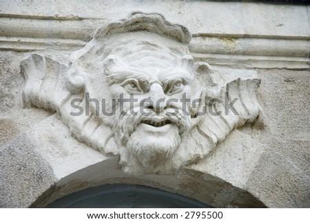 Architectural sculpture - mascaron - on the facade of a 18th century building in Nantes, France. - stock photo