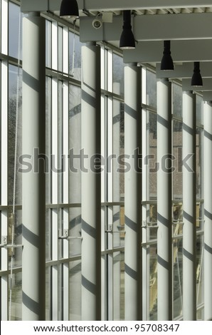 Architectural symmetry: Interior view of columns and windows along hallway of state  university - stock photo