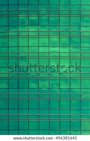 Architectural texture office building. Where glass Windows green on a metal frame.