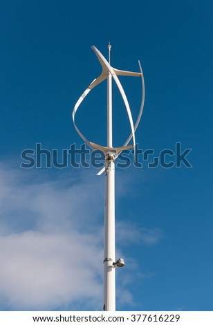 Architectural wind turbines with vertical axis generating green eco power - stock photo