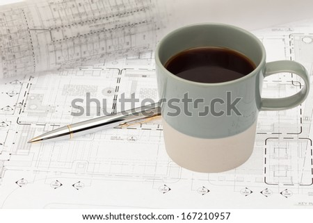 Architectural work blueprint coffee cup stock photo edit now architectural work with blueprint and coffee cup malvernweather Images