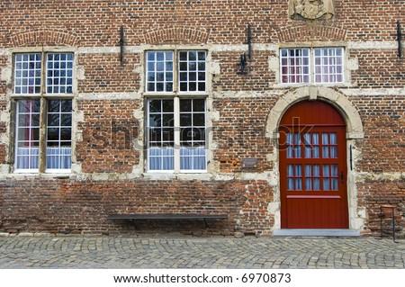 Architecture abbey Tongerlo red door view - stock photo