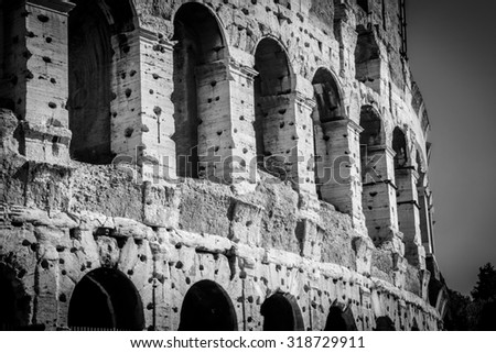 Architecture and arches of the Colosseum in Rome, Italy. Vintage old film processing.