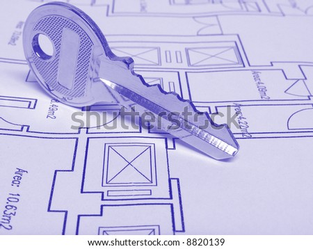 Architecture and real estate concept: House key on a house plan (Blue tone) - stock photo