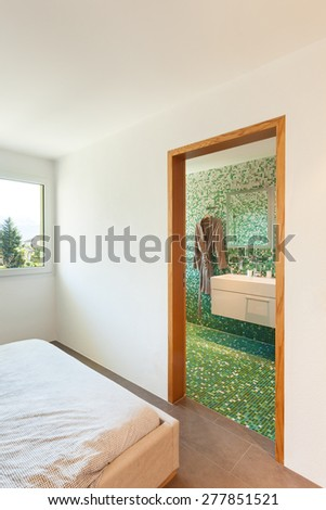 Architecture, apartment furnished, bedroom with bathroom - stock photo
