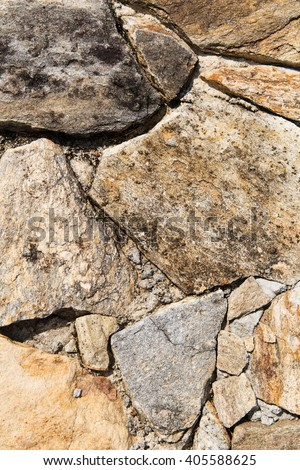 architecture, brickwork and exterior concept - close up of rock texture outdoors