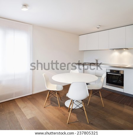 Architecture, comfortable apartment, white kitchen view - stock photo