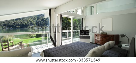 Architecture, comfortable bedroom of a modern house - stock photo