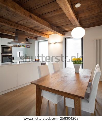 Architecture, comfortable loft furnished, dining room - stock photo