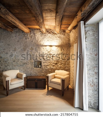 Architecture, comfortable loft furnished, lounge with two armchairs - stock photo
