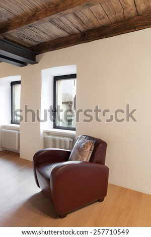 Architecture, comfortable loft furnished, room with armchair - stock photo
