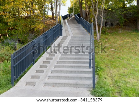architecture concept - stair case with railings in autumn park - stock photo