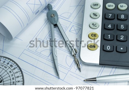 Architecture concept with building plans and architectural tools - stock photo