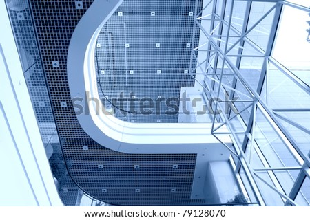 Architecture conceptual image. View on modern building inside them.