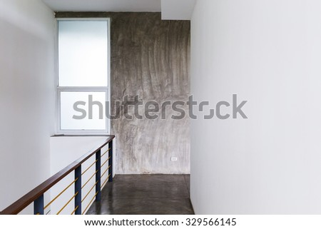 architecture design of house, passageway cement floor and white wall with baluster in modern room  - stock photo