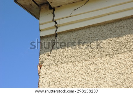Architecture detail of damaged house corner dilapidated old building facade wall. Private abandoned home fall to ruin.  - stock photo