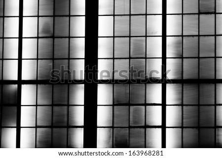architecture detail of illuminated glas facade - stock photo