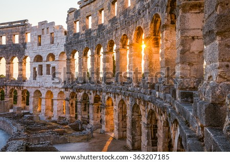 Architecture Details of the Roman Amphitheater Arena in Sunny Summer Evening. Famous Travel Destination in Pula, Croatia. - stock photo