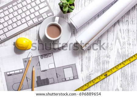 Architecture Drawing And Tools On Light Wooden Desk Top View