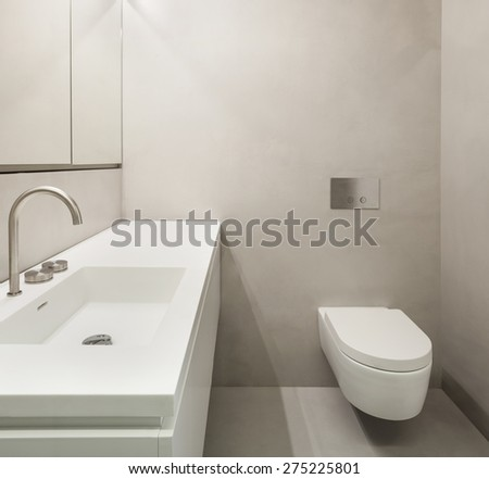 Architecture, empty bathroom in cement of new apartment - stock photo