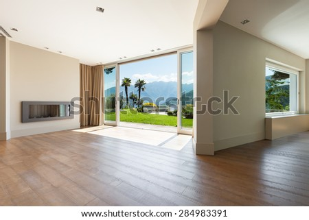 Architecture, empty living room with large windows - stock photo
